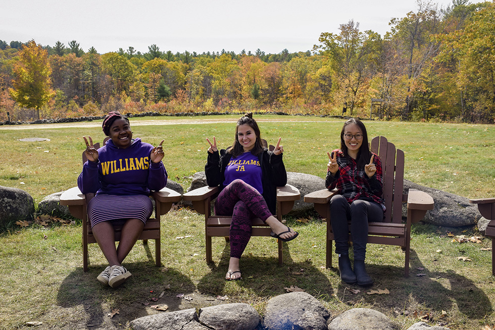 students relaxing on Stone HIll