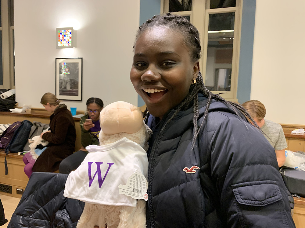 student posing with Williams cow doll