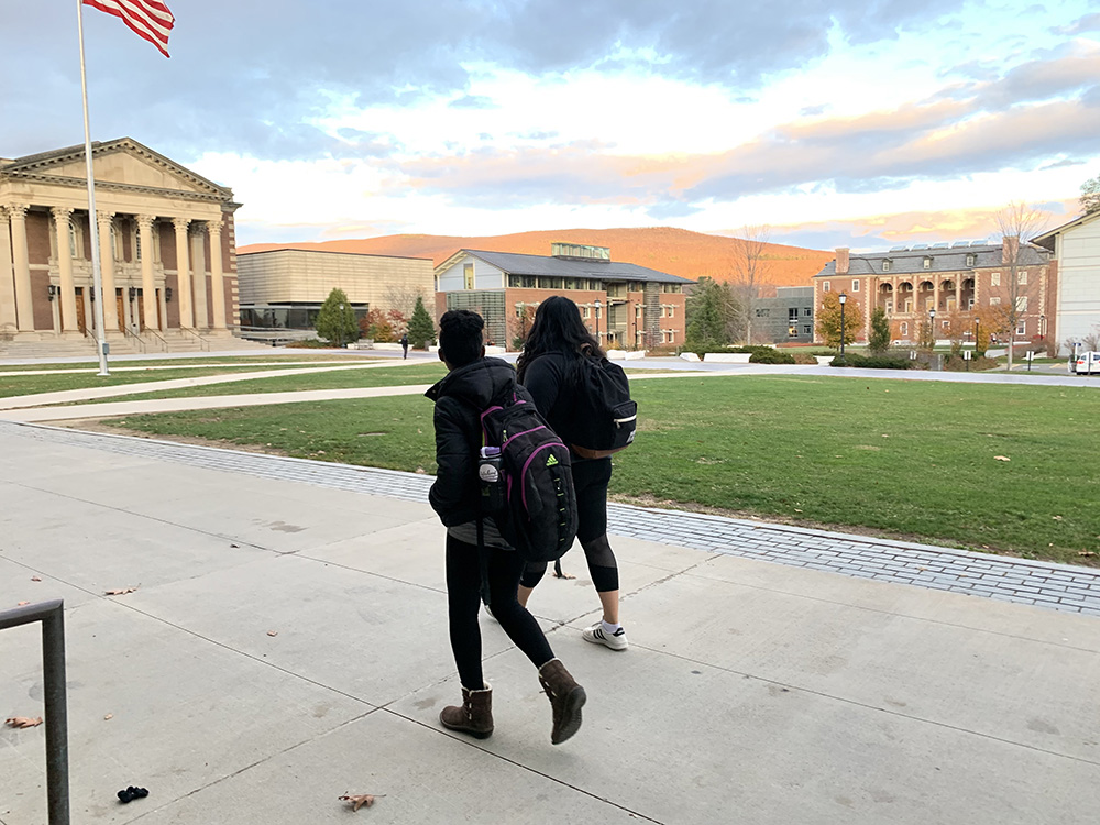 two students walking in Library Quad
