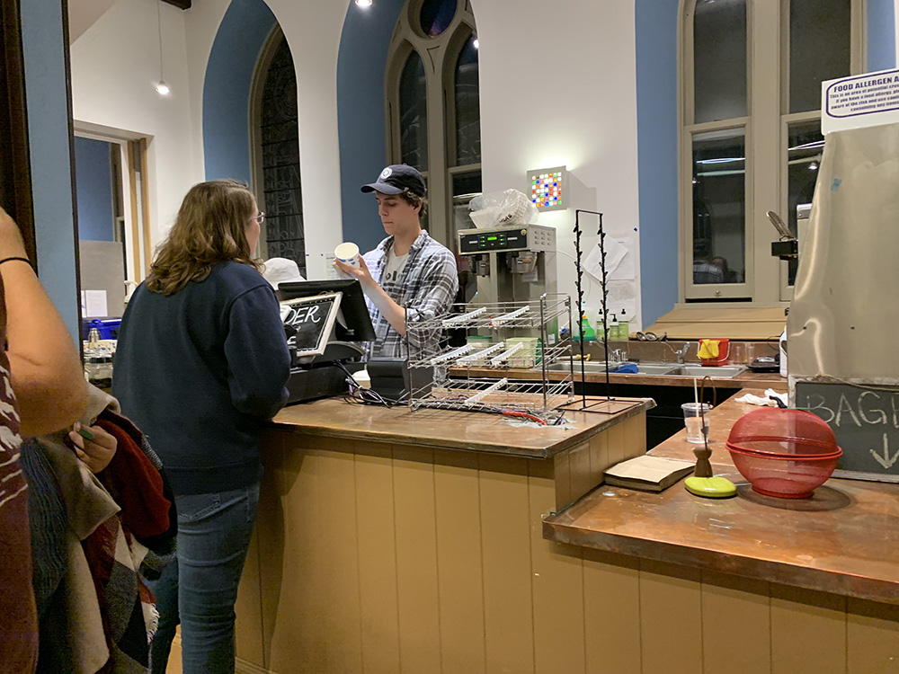 student being served at Goodrich coffee bar
