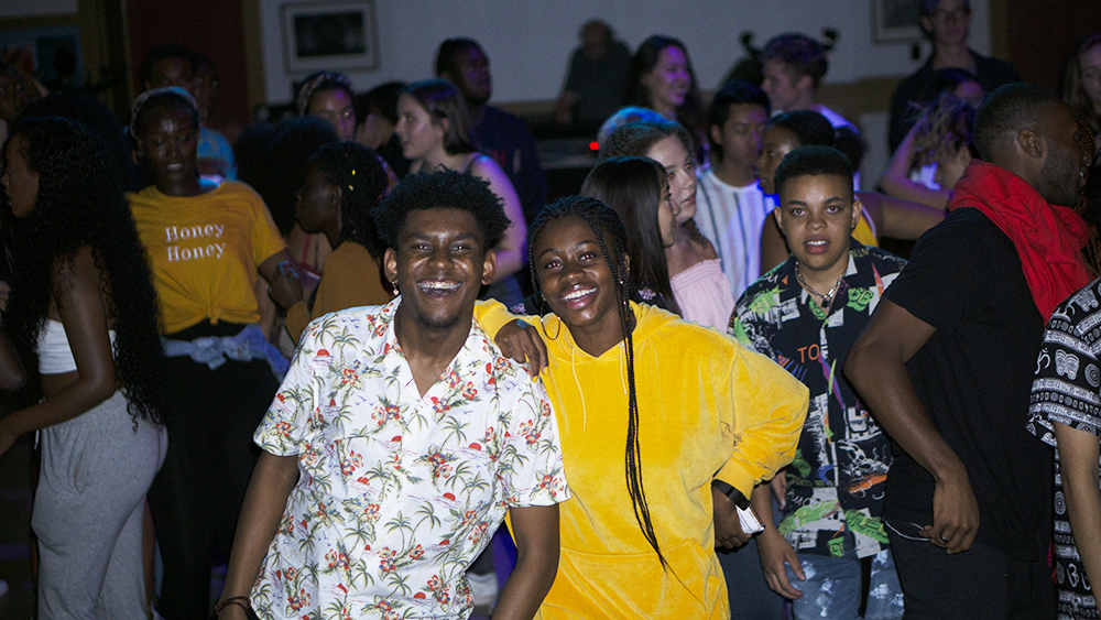 students posing at dance party