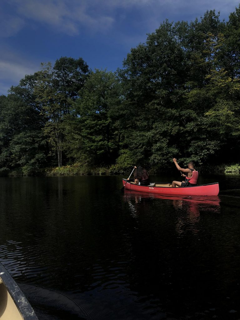 student canoeing