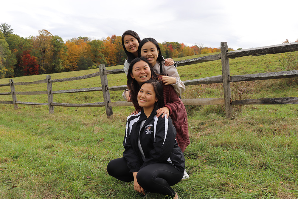 students posing on Stone Hill
