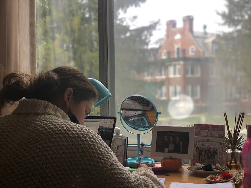 student studying in dorm room