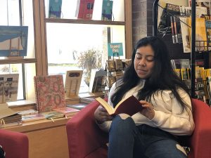 student reading in Williams bookstore