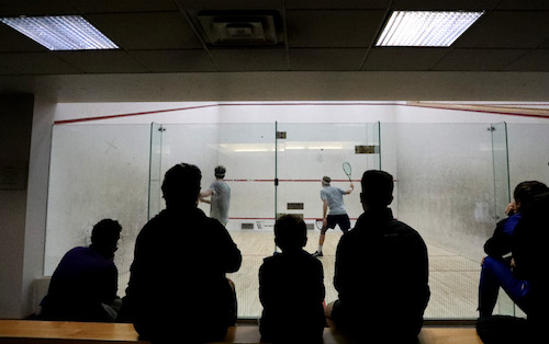 People watching squash match
