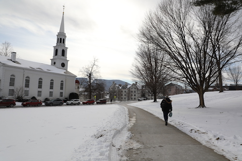 Person walking on sidewalk between Paresky and the Congregational Church