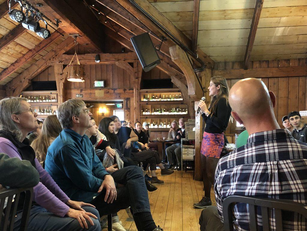 People listening to Log Lunch speaker