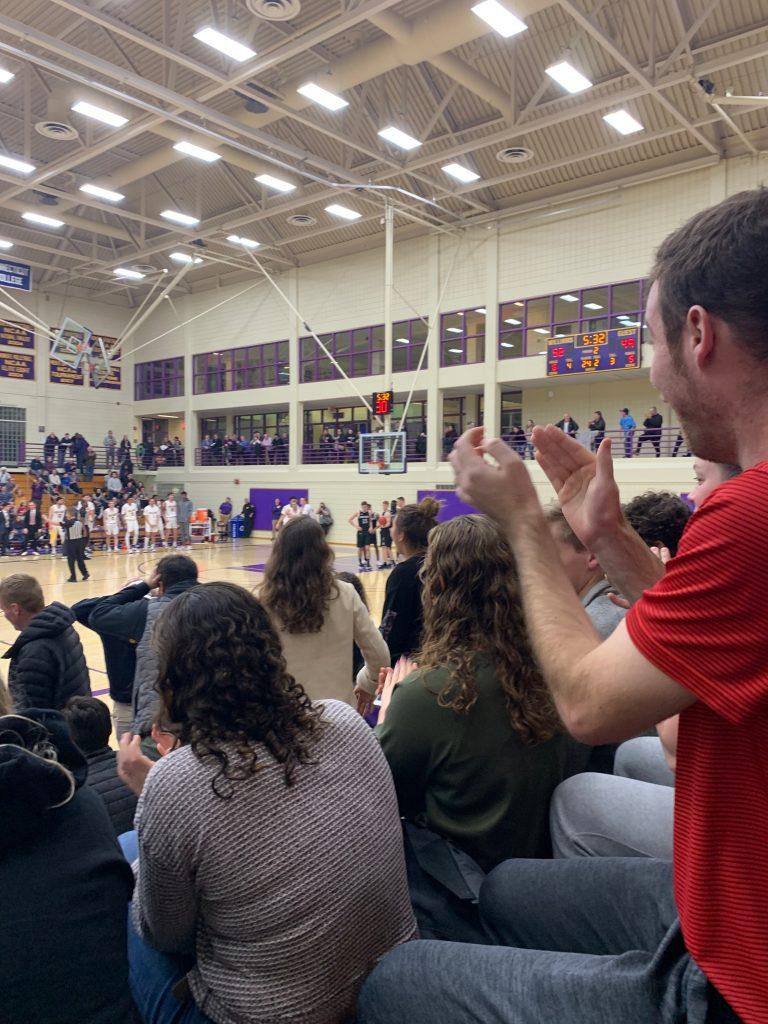 Spectators watching basketball game in Chandler Gymnasium